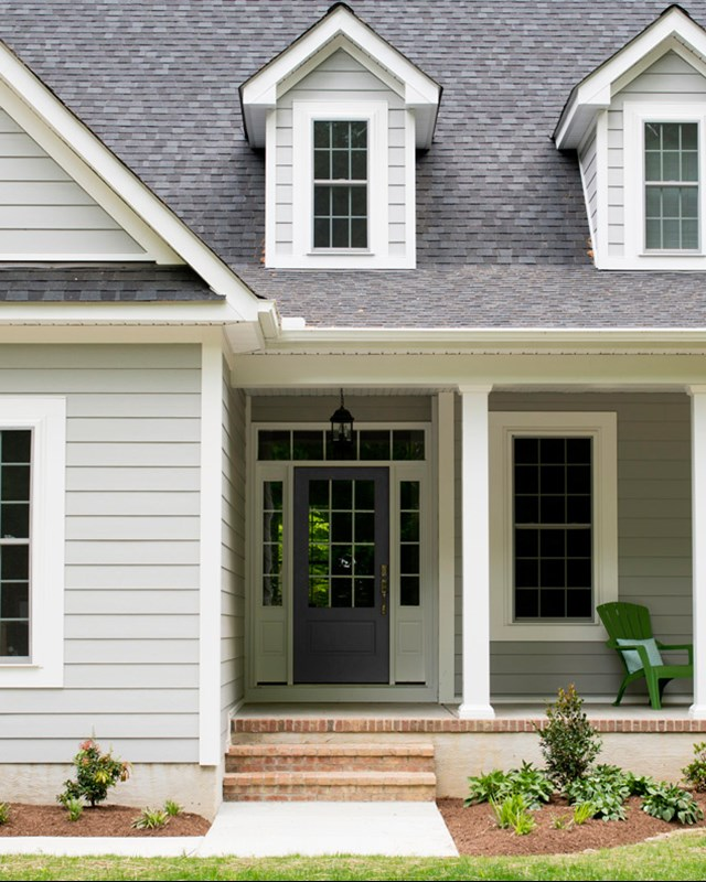 cape style home with gray lap siding