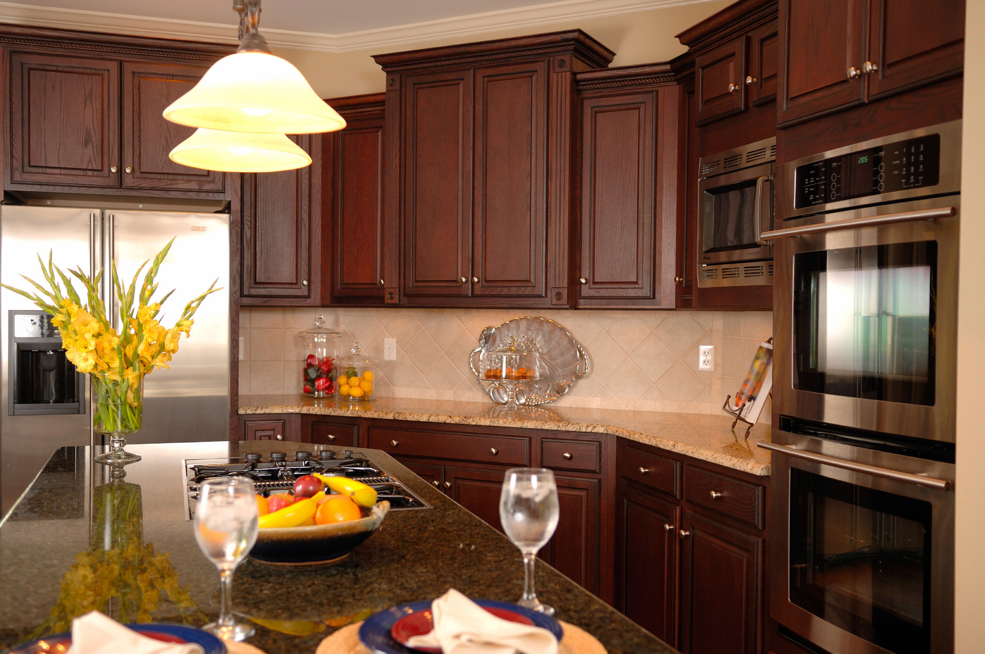 Kitchen With Dark Cabinets And Stainless Appliances ...