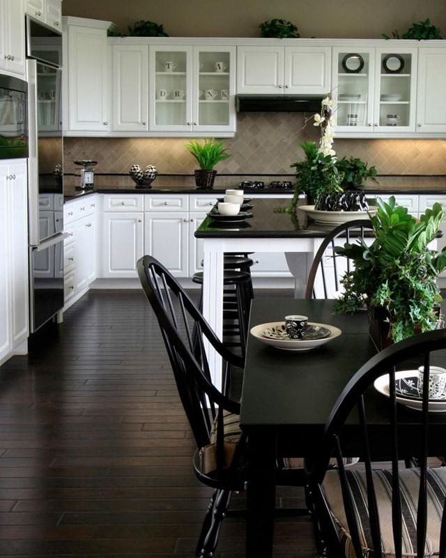 kitchen with white cabinets and black appliances
