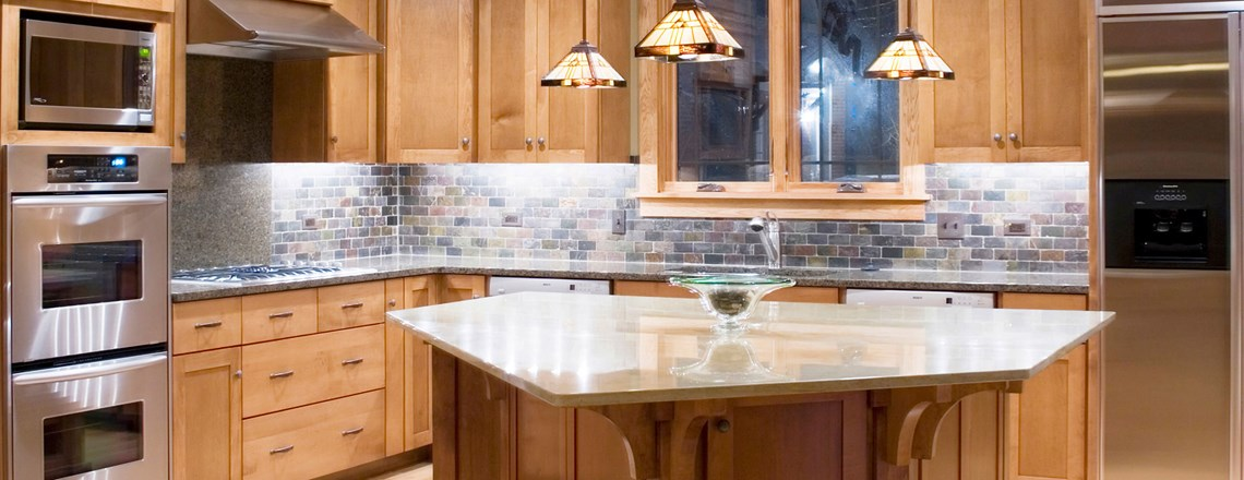 kitchen with wood cabinets and tile backsplash