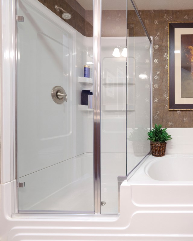 bathroom with tub and shower system