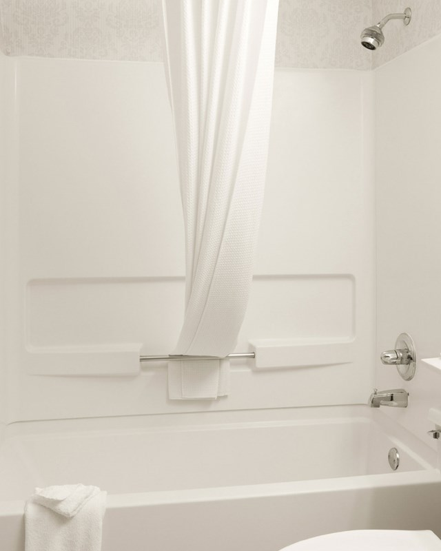 white bathroom with bath and shower
