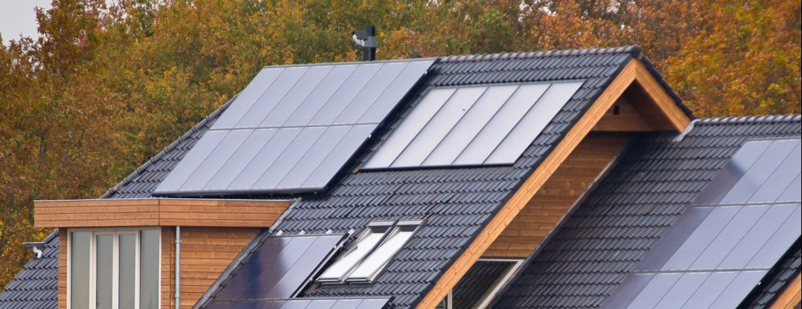 solar panels on the roof of brick house