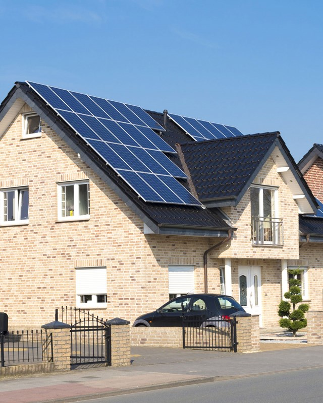 solar panels on light brick home