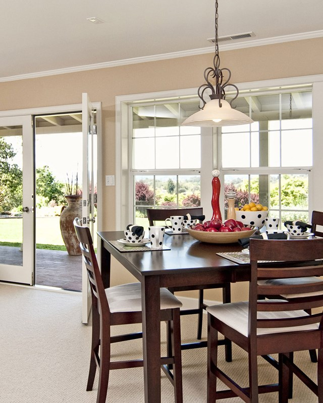 dining table in front of colonial grid windows