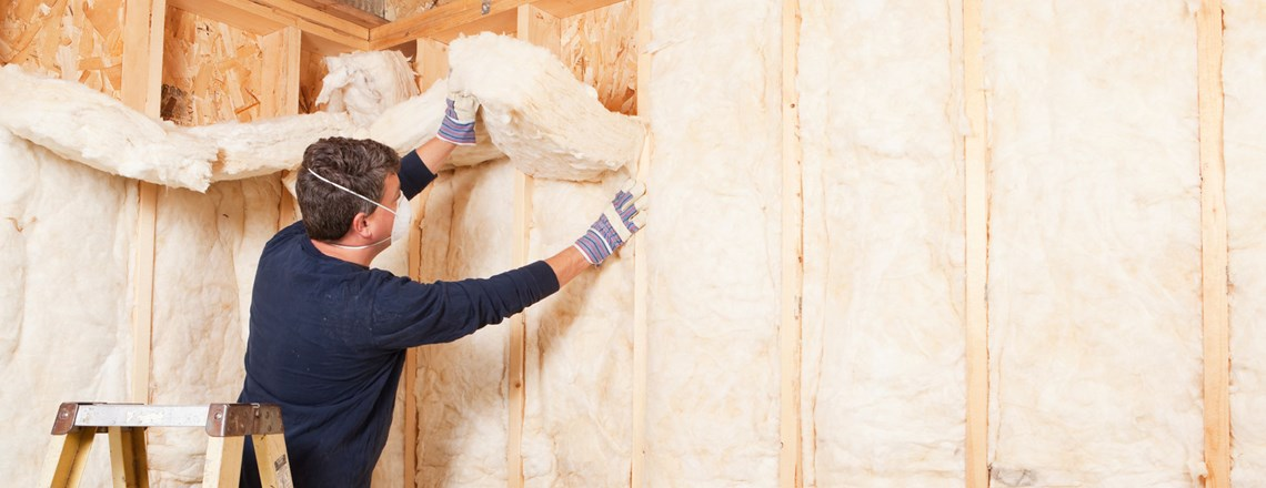 contractor installing wall insulation