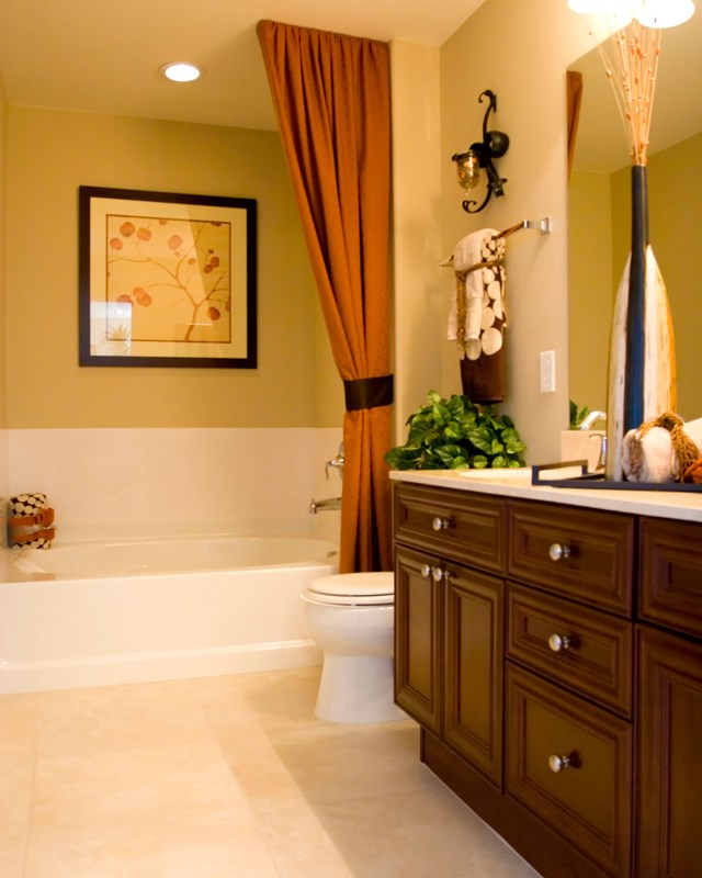 decorated bathroom with tile floor